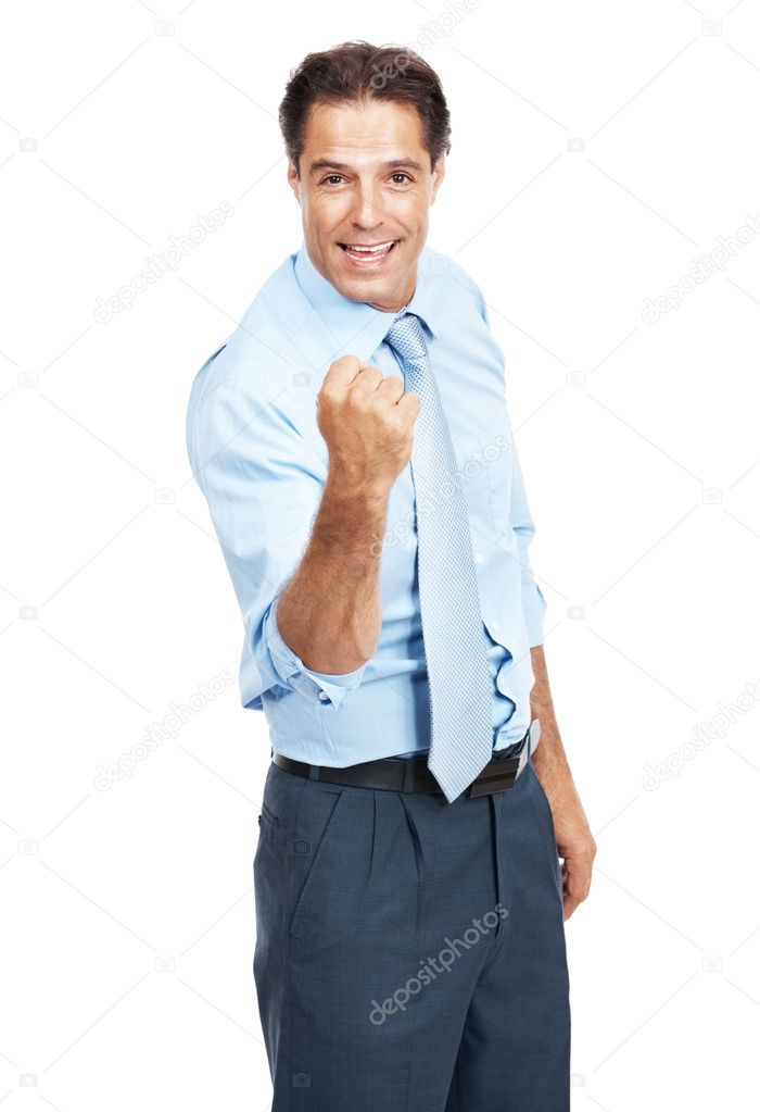 Portrait of a successful young businessman gesturing fist in air isolated against white background — Stock Photo #7842283