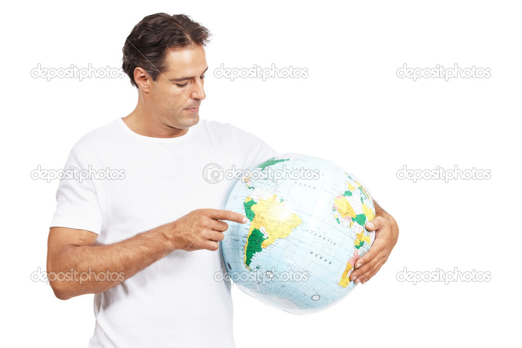 Portrait of a mature man pointing at a terrestrial globe in his hand isolated on white background — Stock Photo #7842820