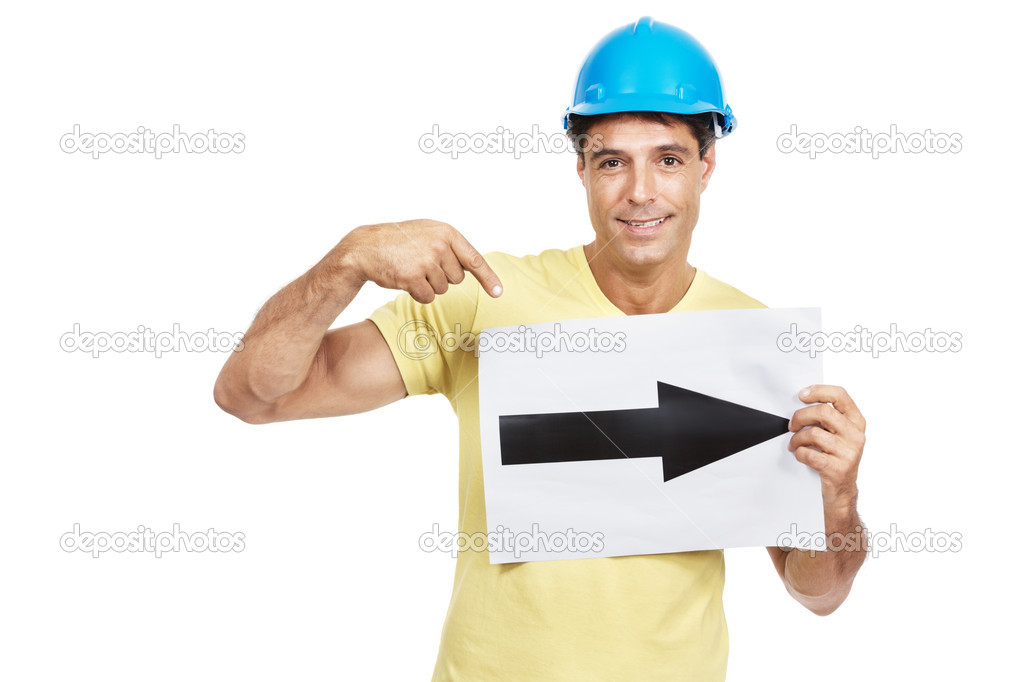 Portrait of a happy mature engineer standing with sign board and pointing over white background — Stock Photo #7842839