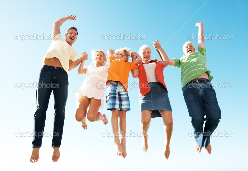 Portrait of a lively excited family jumping in air against sky - Enjoying holidays  Stock Photo #7845313