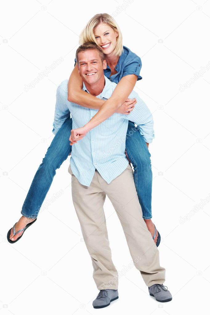 Portrait of handsome Caucasian man caring cheerful woman on shoulders isolated on white background — Stock Photo #7849810