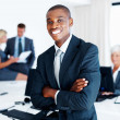 Smiling African American business man with colleagues - Stock Photo