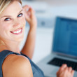 Pretty woman using laptop - Stock Photo