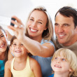 Family taking self portrait - Stock Photo