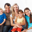 Happy family sitting together - Stockfoto
