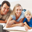Royalty-Free Stock Photo: Happy family with laptop
