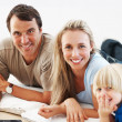Happy family of three - Stock Photo
