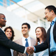 Royalty-Free Stock Photo: Mixed race business shaking hands