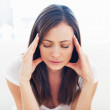 Woman suffering from headache - Stock Photo