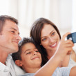 Royalty-Free Stock Photo: Family taking self portrait at home