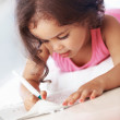 Little girl writing - Foto Stock