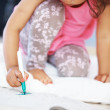 Cute girl coloring - Stock Photo
