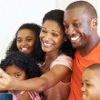 Happy family taking self portrait - Stock Photo
