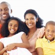 African American family of four smiling together - Stockfoto