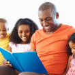 Royalty-Free Stock Photo: Father reading to his kids