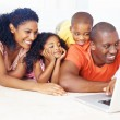 African American family using laptop - Stock Photo