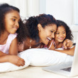 Royalty-Free Stock Photo: Woman using laptop with beautiful daughters