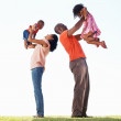 Playful family of four - Stock Photo