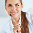 Smiling business woman contemplating - Stock Photo
