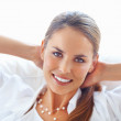 Relaxed young woman smiling - Stock Photo