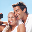 Young couple taking self portrait - Foto Stock