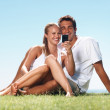 Cute couple taking self portrait - Foto Stock