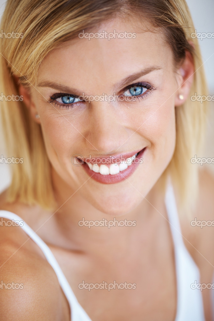 Closeup portrait of beautiful Caucasian smiling in white tank top — Stock Photo #7852999