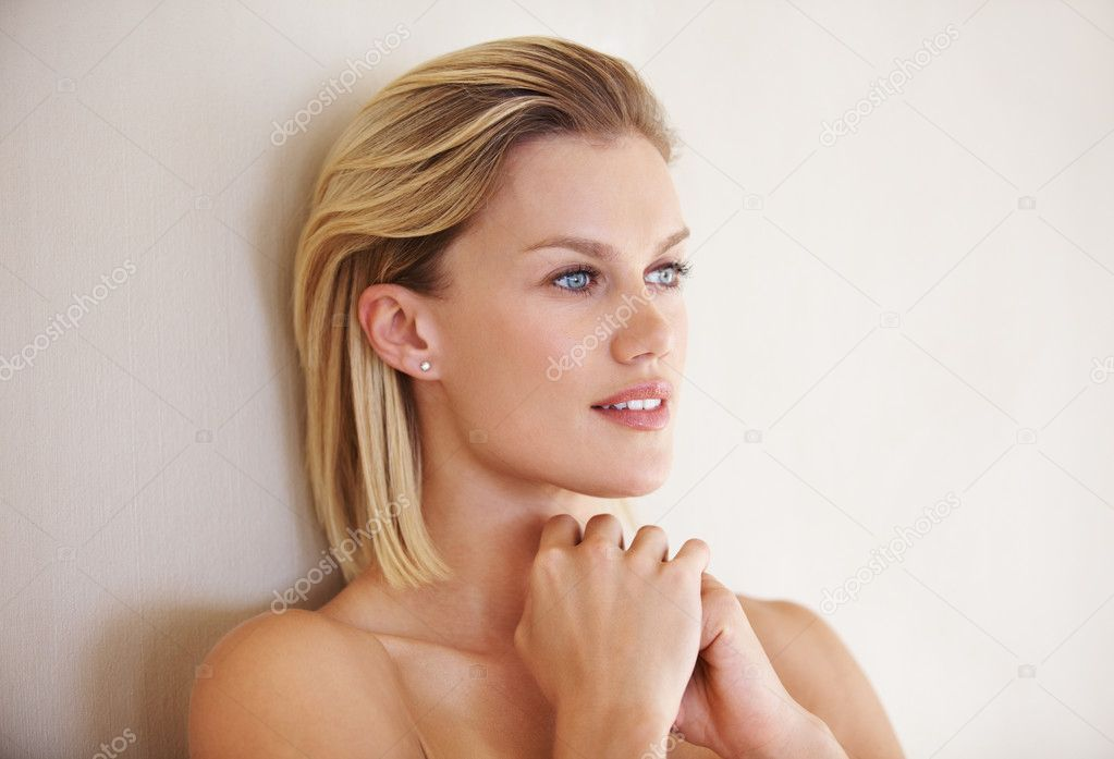 Closeup of beautiful Caucasian woman looking away in deep thought — Stock Photo #7853007