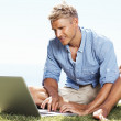 Royalty-Free Stock Photo: Young man with laptop outdoors