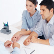 Couple meeting financial advisor - Stock Photo