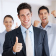 Successful business man with supporting team - Stock Photo