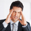 Business man suffering from headache - Stock Photo
