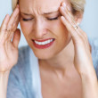 Woman suffering from head pain - Stock Photo