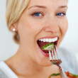 Royalty-Free Stock Photo: Woman eating salad
