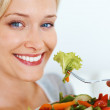 Royalty-Free Stock Photo: Pretty woman eating salad