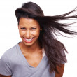 Cute young girl with hair lightly fluttering in the wind against - Stock Photo