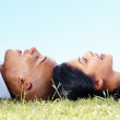 Royalty-Free Stock Photo: Happy couple lying head to head on a meadow