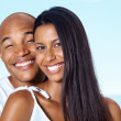 Smiling young guy posing with his girlfriend - Stock Photo