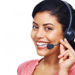 Royalty-Free Stock Photo: Young cute call centre employee smiling over white