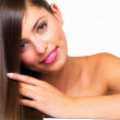 Pretty woman touching her silky hair - Stock Photo