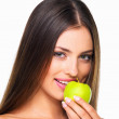 Royalty-Free Stock Photo: Young woman eating an apple