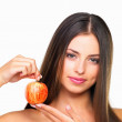 Royalty-Free Stock Photo: Pretty woman holding an apple
