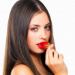 Royalty-Free Stock Photo: Sexy young woman eating strawberry
