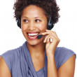 Smiling female executive wearing headset looking away - Stock Photo