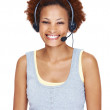 Beautiful young executive in headphones smiling - Stock Photo