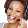 Young female executive wearing headset and smiling - Stock Photo