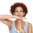 Attractive young woman gesturing time out sign on white - Foto de Stock