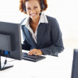 Smiling call center woman - Stock Photo