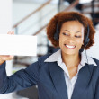 Royalty-Free Stock Photo: Happy woman holding blank white card