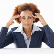 Business woman having headache - Stock Photo